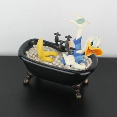 Vintage Donald Duck bathing statue