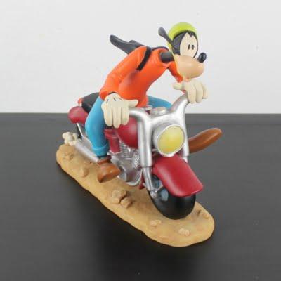 Vintage Goofy on a motor statue by Walt Disney