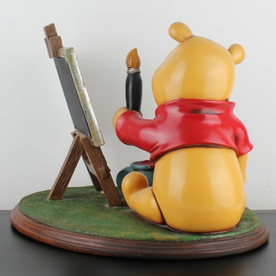 Winnie the Pooh as painter statue picture frame