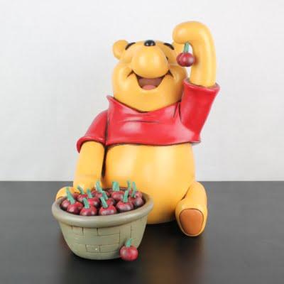Vintage big statue of Winnie the Pooh eating cherries