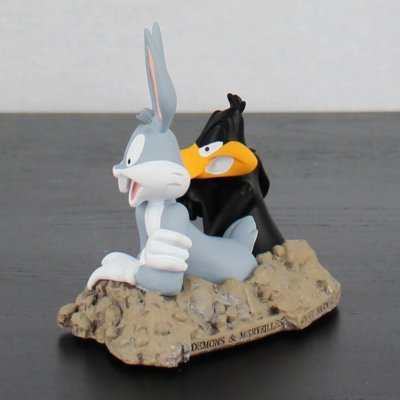 Daffy Duck in the rabbit hole with Bugs Bunny by Demons and Merveilles in license of Warner Bros