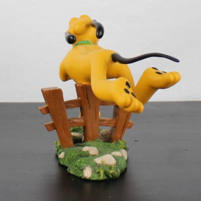 Pluto jumping a fence statue