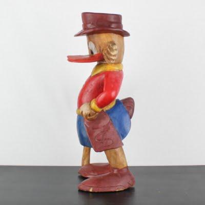 Vintage wooden statue of Scrooge McDuck