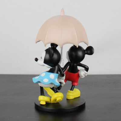 Mickey and Minnie Mouse in the rain statue by Walt Disney