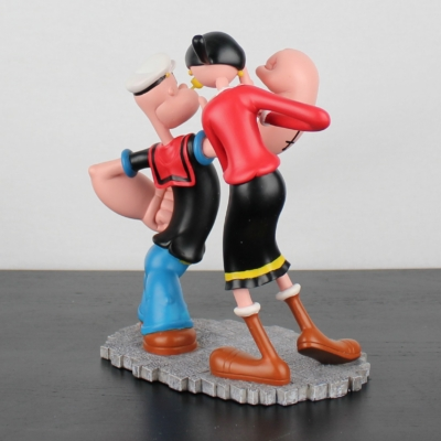Vintage statue of Popeye and Olive Oyl swooning