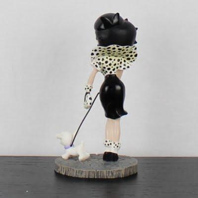 Vintage statue of Betty Boop walking Pugsley