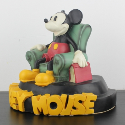 Mickey Mouse in his reading chair statue by Demons and Merveilles Site title Title Separator