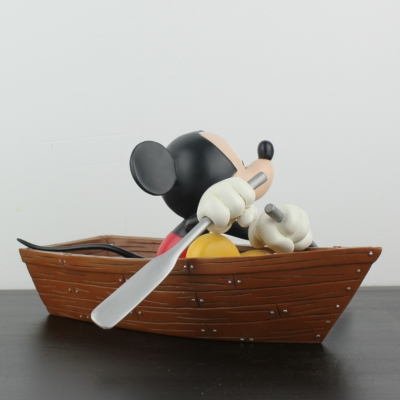 Mickey Mouse in his rowing boat statue