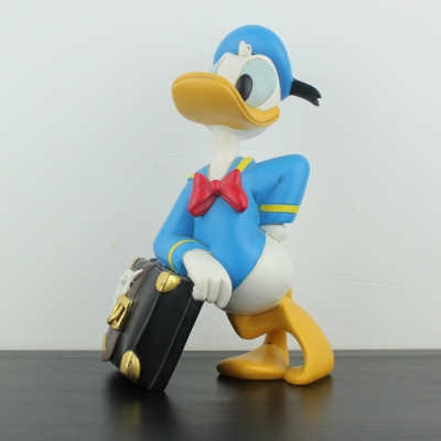 Donald Duck relaxing on his suitcase by Peter Mook